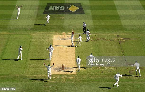 Australia celebrate winning the test as Mitchell Starc of Australia gets the wicket of Yasir Shah of Pakistan during day five of the Second Test...