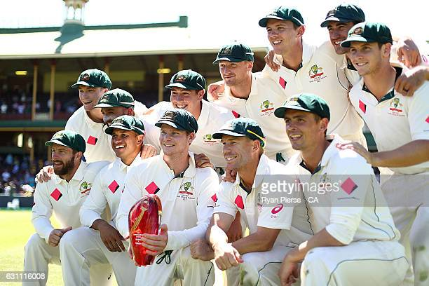 Australia celebrate with the series trophy during day five of the Third Test match between Australia and Pakistan at Sydney Cricket Ground on January...