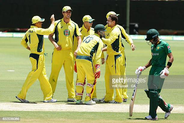 Australia celebrates after taking the wicket of Sharjeel Khan of Pakistan during game three of the One Day International series between Australia and...