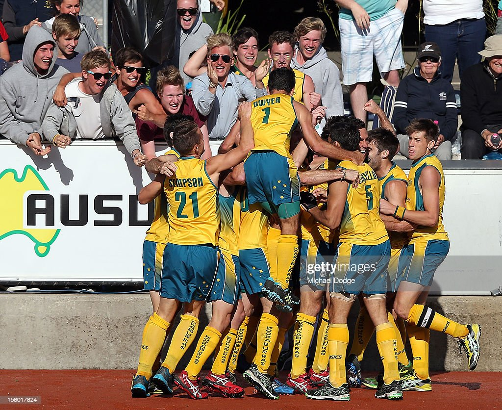 Australia celebrates scoring the winning goal in extra time to defeat the Netherlands in the final of the 2012 Champions Trophy at State Netball Hockey Centre on December 9, 2012 in Melbourne, Australia.
