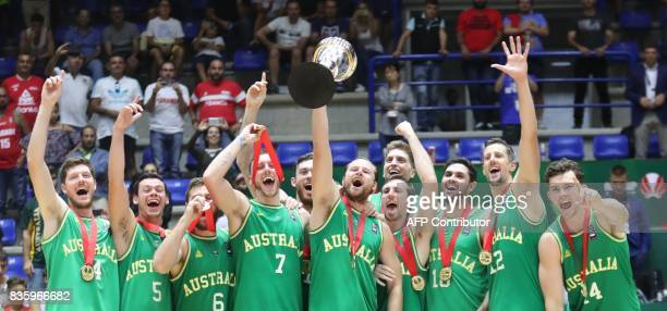 Australia celebrates their Gold Medal after defeating Iran during their 2017 FIBA Asia Cup final basketball match in the Lebanese town of Zouk Mikael...