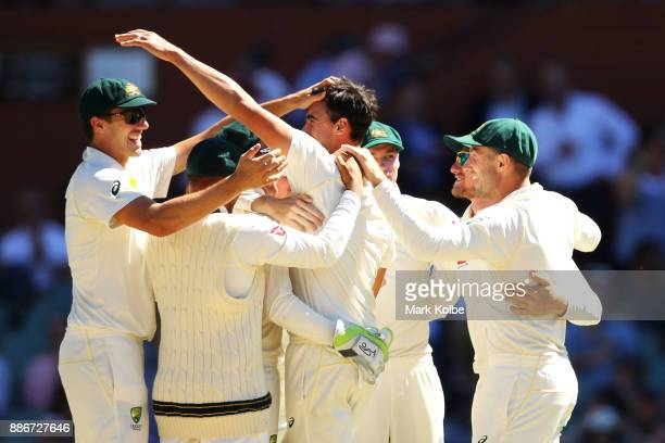 Australia celebrates victory after Mitchell Starc of Australia took the wicket of Jonny Bairstow of England to win the test during day five of the...
