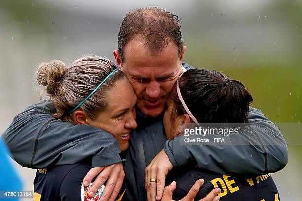 Australia Coach Alen Stajcic hugs Kyah Simon and Lisa de Vanna of Australia after the FIFA Women's World Cup 2015 Round of 16 match between Brazil...