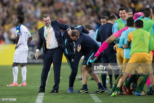 Australia Coach Ange Postecoglou and Australian bench players and staff celebrate a goal during the 2018 FIFA World Cup Qualifiers Leg 2 match...
