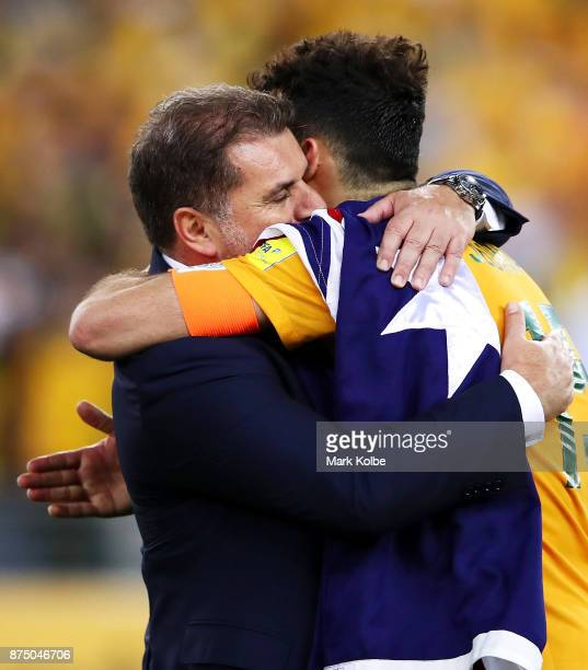 Australia Coach Ange Postecoglou and Mile Jedinak of Australia celebrate victory during the 2018 FIFA World Cup Qualifiers Leg 2 match between the...