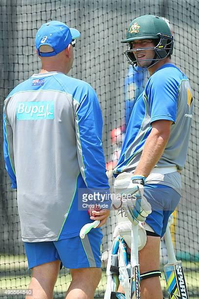Australia coach Darren Lehmann and Joe Burns talk during the Australia nets session at The Gabba on November 4 2015 in Brisbane Australia