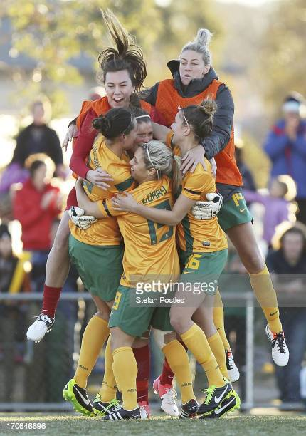 Australia congratulates their goal keeper Brianna Davey after winning the penalty shoot out during the Women's International match between the...