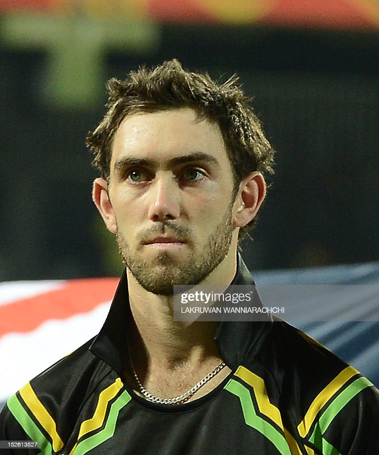 Australia cricketer Glenn Maxwell observes the national anthem before the start of the ICC Twenty20 Cricket World Cup match between Australia and West Indies at the R. Premadasa Stadium in Colombo on September 22, 2012.