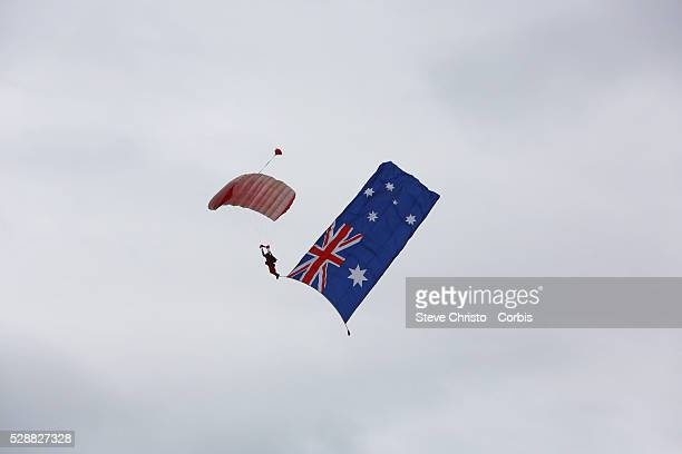 Australia Day celebrations on Sydney Harbour foreshore A Parachutist with an Australian flag lands in the harbour Sydney Australia Sunday 26th...