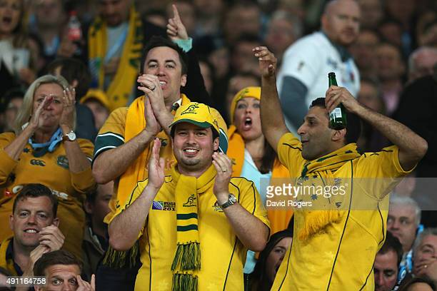Australia fans celebrate during the 2015 Rugby World Cup Pool A match between England and Australia at Twickenham Stadium on October 3 2015 in London...