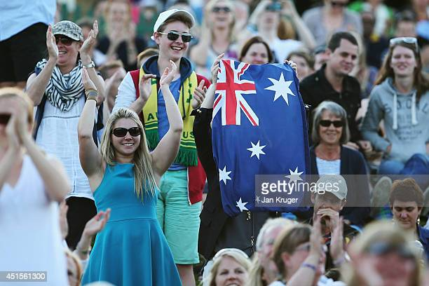 Australia fans celebrate on Murray Mound as they watch Nick Kyrgios of Australia win his Gentlemen's Singles fourth round match against Rafael Nadal...