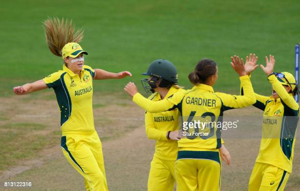 Australia fielder Ellyse Perry joins in the celebrations after Ashleigh Gardner had dismissed India batsman Smrti Mandhana during the ICC Women's...