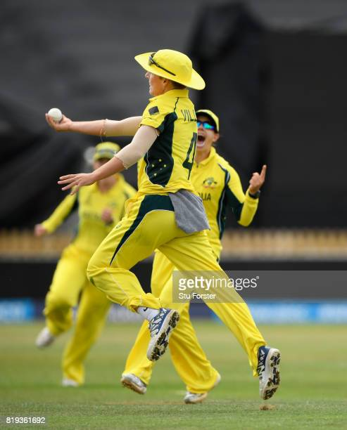 Australia fielder Nicole Bolton celebrates with Elyse Villani after Villani had caught India batsman Smitri Mandhana during the ICC Women's World Cup...