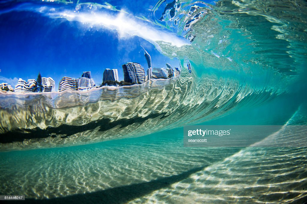 'Australia, Gold Coast, City view through wave'
