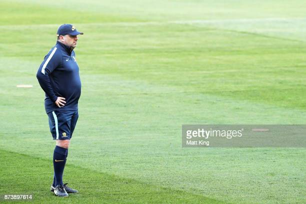 Australia head coach Ange Postecoglou looks on during an Australian Socceroos training session at ANZ Stadium ahead of their World Cup 2018...