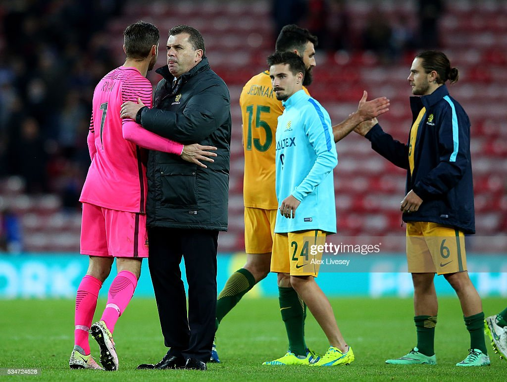 Australia head coach Angelos Postecoglou shakes hands with his players following the International Friendly match between England and Australia at Stadium of Light on May 27, 2016 in Sunderland, England.