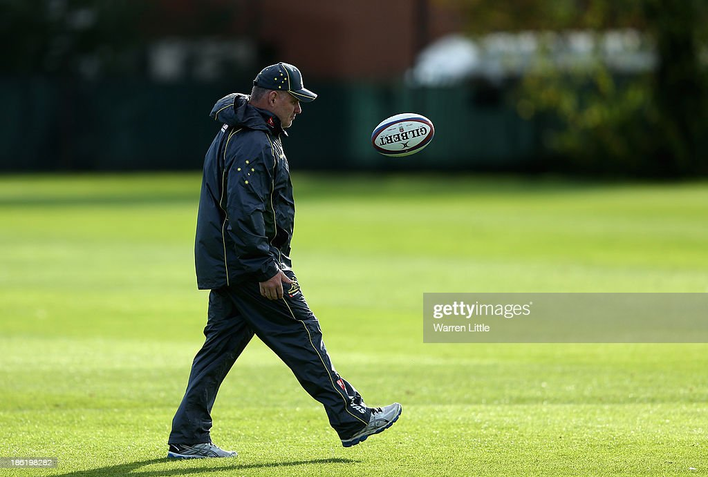 Australia head coach <a gi-track='captionPersonalityLinkClicked' href=/galleries/search?phrase=Ewen+McKenzie&family=editorial&specificpeople=234798 ng-click='$event.stopPropagation()'>Ewen McKenzie</a> keeps an eye on training at the Latyrmer School on October 29, 2013 in London, England.
