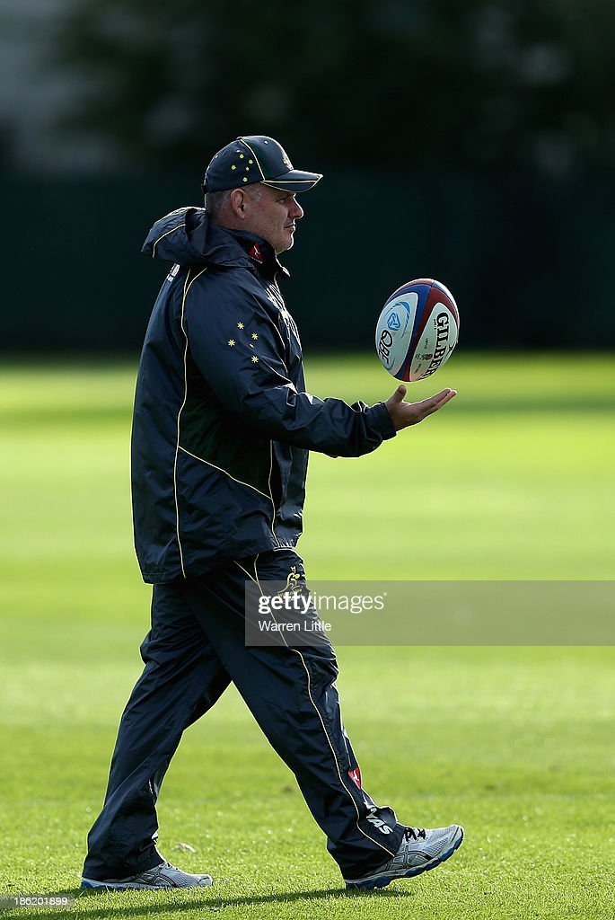Australia head coach Ewen McKenzie keeps an eye on training at the Latyrmer School on October 29, 2013 in London, England.