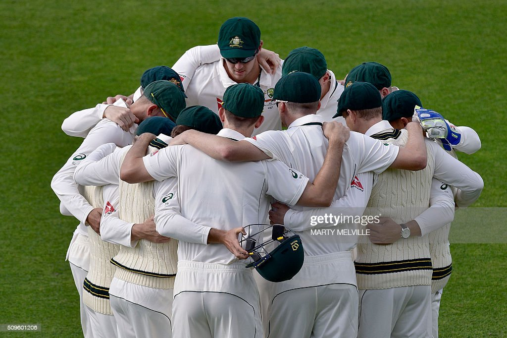 Australia huddle during day one of the first cricket international five-day Test match between New Zealand and Australia at Basin Reserve in Wellington on February 12, 2016. / AFP / Marty Melville