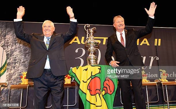 Australia II skipper John Bertrand and owner Alan Bond present a replica of the America's Cup trophy they won at a luncheon to celebrate the 30th...