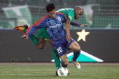 Australia International player Da Costa Reinaldo Elias of Beijing Guoan challenges Wu Xi of Shanghai Shenhua during the Chinese Super League match at...