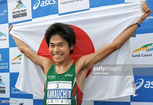 COAST Australia Japan's Yuki Kawauchi celebrates after winning the Gold Coast Marathon in Queensland Australia on July 7 2013 Kawauchi finished in 2...