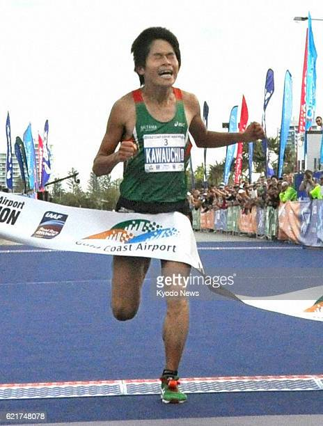 COAST Australia Japan's Yuki Kawauchi crosses the finishing line to win the Gold Coast Marathon in Queensland Australia on July 7 2013 Kawauchi...