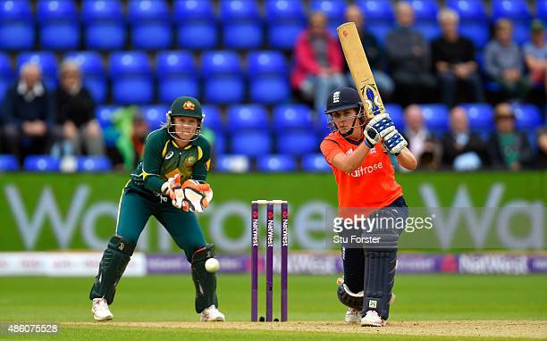 Australia keeper Alyssa Healy looks on as Natalie Sciver hits out during the 3rd NatWest T20 of the Women's Ashes Series between England and...