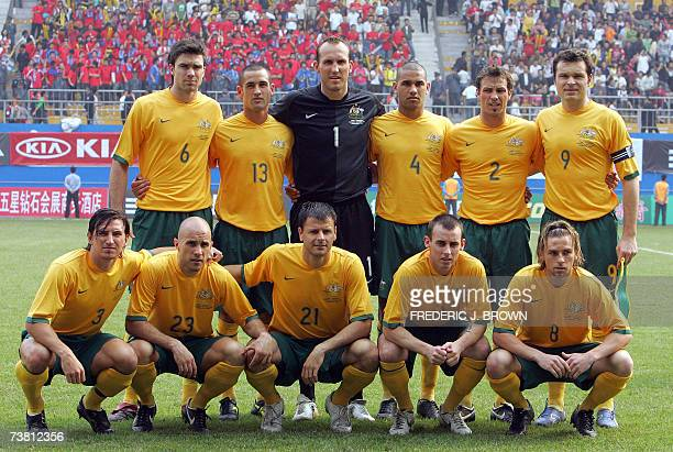 Australia lineup for a team photo ahead of their 20 victory over China in an Asian Cup warmup match in Guangzhou 24 March 2007 in southern China's...