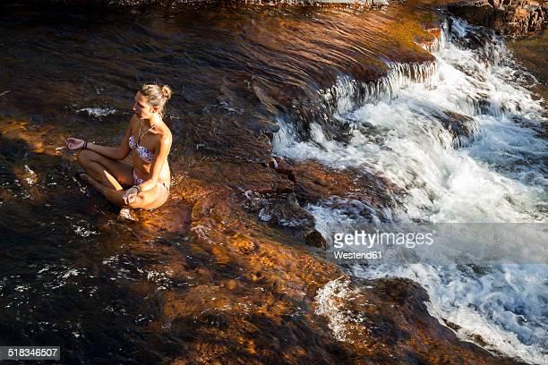 Australia, Litchfield National Park, Woman relaxing at Buley Rockhole
