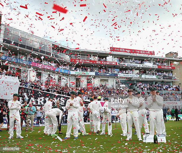 Australia look on as England lift the Ashes Urn during day four of the 5th Investec Ashes Test match between England and Australia at The Kia Oval on...