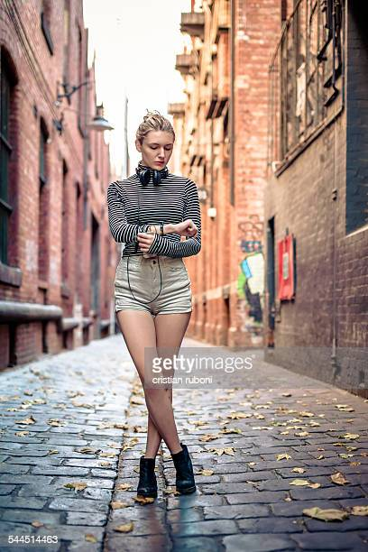 Australia, Melbourne, Woman standing in alley