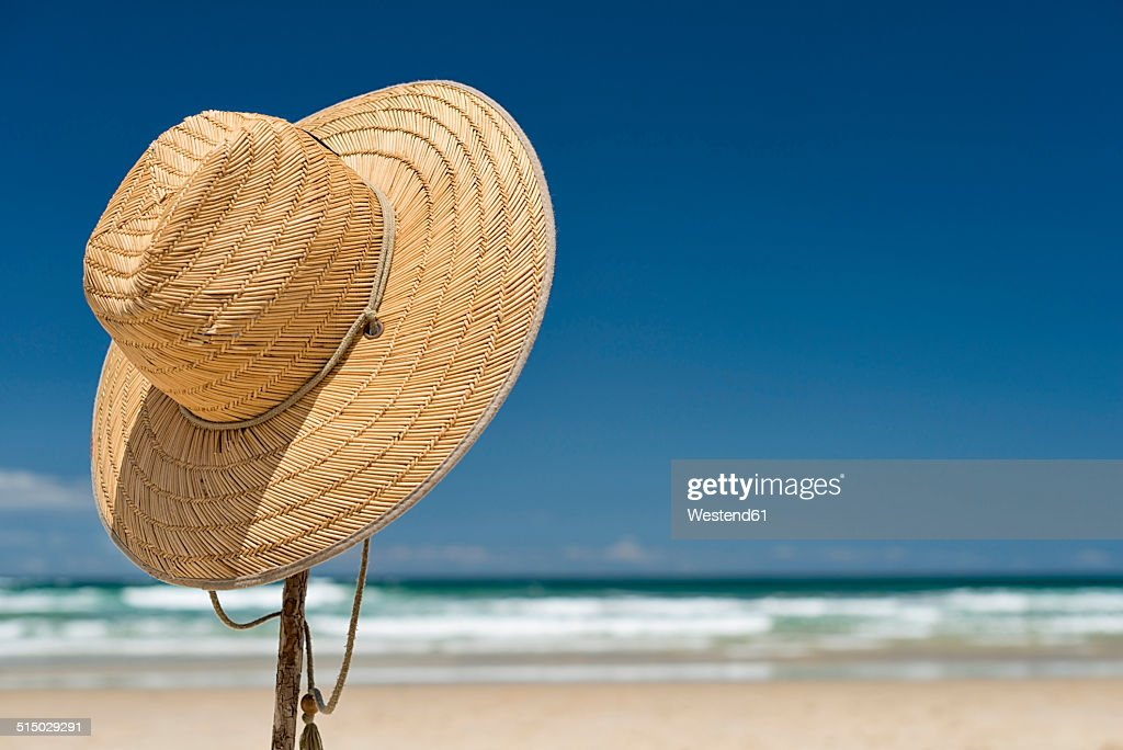 Australia, New South Wales, Byron Bay, Broken Head nature reserve, straw hat on stick on beach