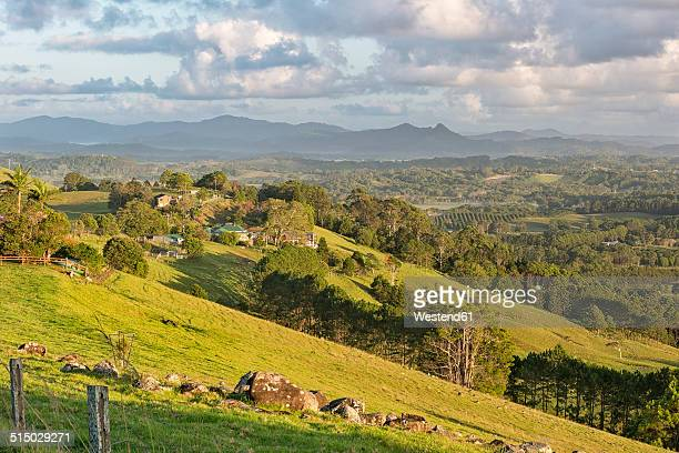 Australia, New South Wales, Byron Bay, early morning view over hilly farmland to the Nightcap national park