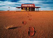Australia, New South Wales, man standing in door way to hotel