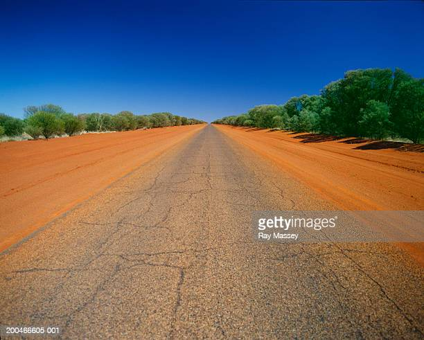 Australia, Northern Territory, straight road in rural landscape