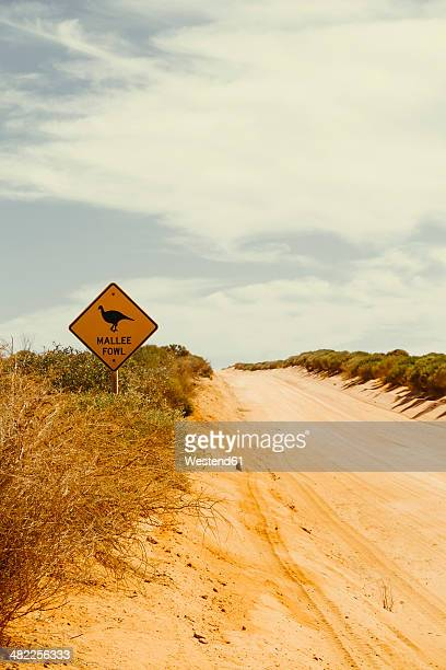 Australia, Outback, Animal crossing sign on sandy road
