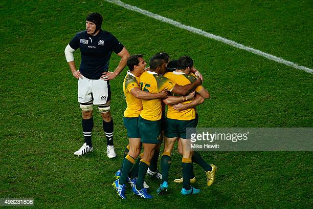 Australia players celebrate after the 2015 Rugby World Cup Quarter Final match between Australia and Scotland at Twickenham Stadium on October 18...