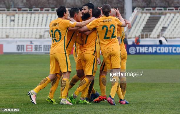 Australia players celebrate their goal during the FIFA World Cup 2018 qualifier between Iraq and Australia at Shahid Dastgerdi Stadium in the Iranian...