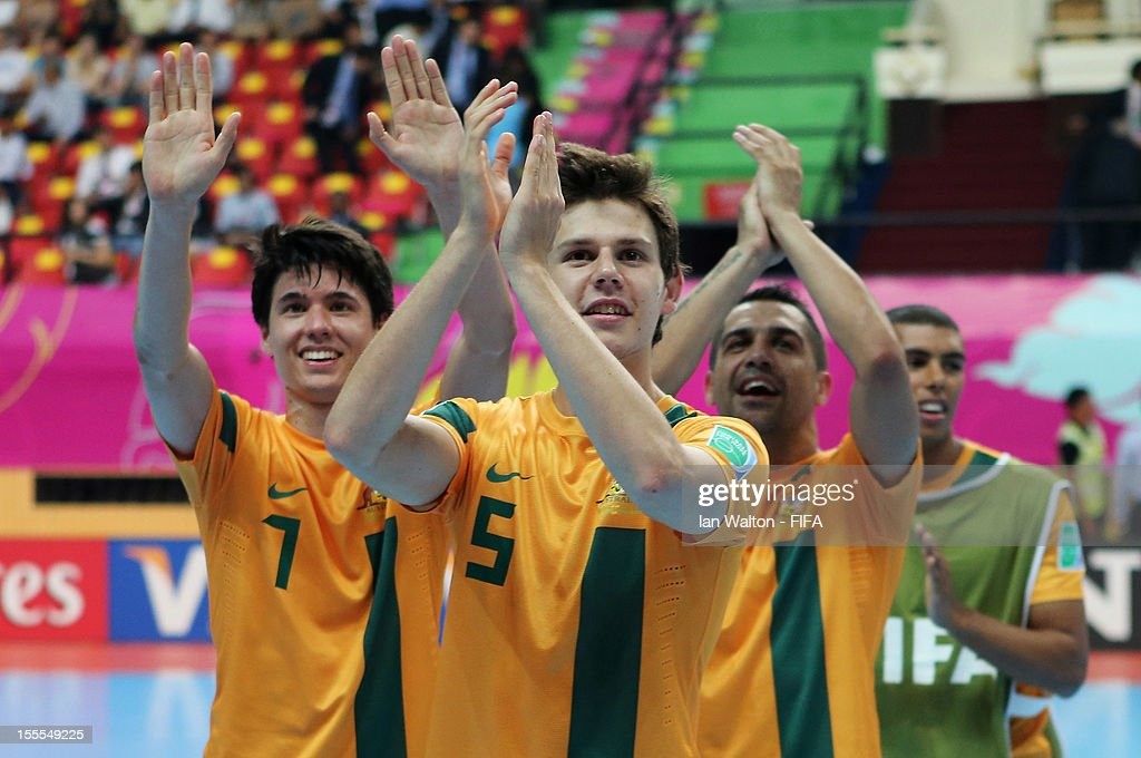 Australia players celebrate their victory in the FIFA Futsal World Cup Thailand 2012, Group D match between Australia and Mexico at Nimibutr Stadium on November 5, 2012 in Bangkok, Thailand.