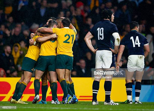 Australia players celebrate victory after the 2015 Rugby World Cup Quarter Final match between Australia and Scotland at Twickenham Stadium on...