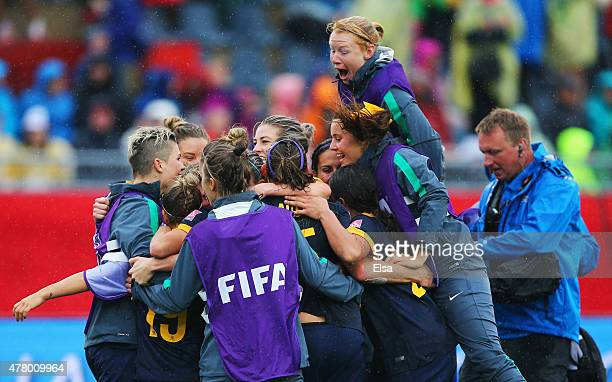 Australia players celebrate victory after the FIFA Women's World Cup 2015 round of 16 match between Brazil and Australia at Moncton Stadium on June...