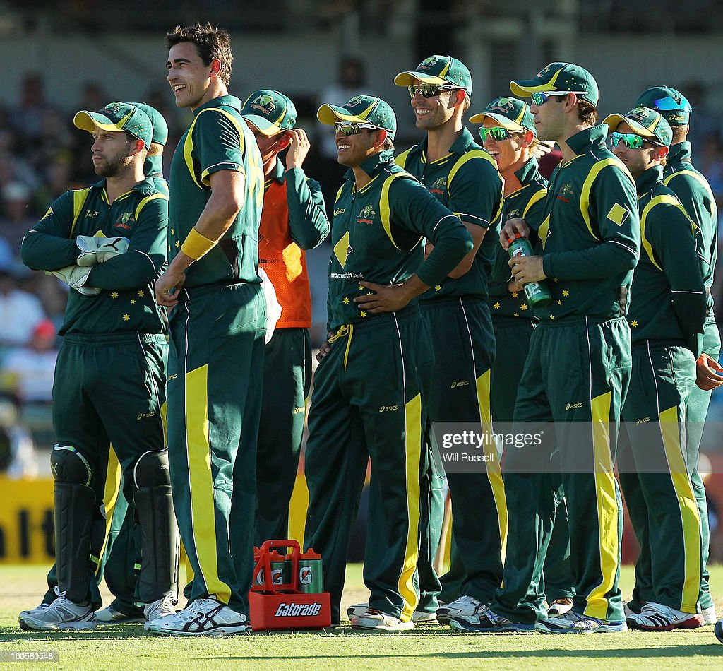 Australia players watch the big screen, awaiting a sucessful challenge against the wicket of Devon Thomas of West Indies during game two of the Commonwealth Bank One Day International Series between Australia and the West Indies at WACA on February 3, 2013 in Perth, Australia.