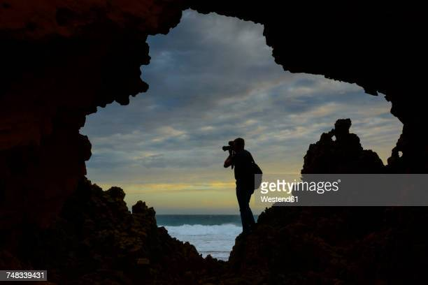 Australia, Port Lincoln, photographer taking pictures at the coast