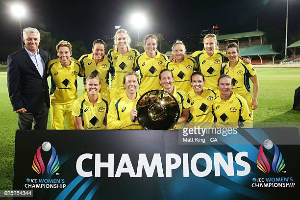 Australia pose with the ICC Womens Championship trophy alongside ICC CEO David Richardson after the women's One Day International match between the...