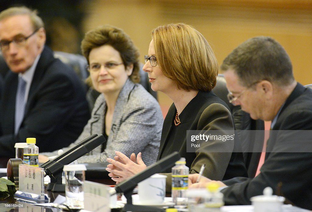 Australia Prime Minister Julia Gillard (2nd R) talks with Chinese Premier Li Keqiang (not pictured) during a meeting at the Great Hall of the People on April 9, 2013 in Beijing, China. Gillard spoke of building stronger defense ties with China.
