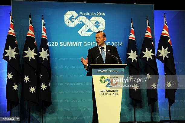 Australia Prime Minister Tony Abbott speaks at a press conference on the final day of the G20 Summit in Brisbane on November 16 2014 The leaders of...