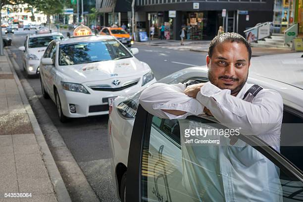 Australia Queensland Brisbane Central Business District Asian Indian man taxi cab driver immigrant