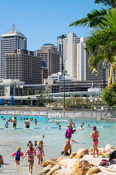 Australia Queensland Brisbane Southbank Parklands Streets Beach sunbathers sand water Central Business District CBD city skyline skyscrapers buildings