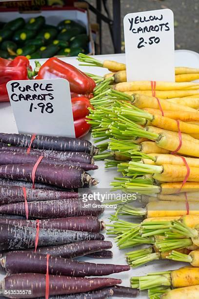Australia Queensland Brisbane West End Davies Park Saturday Market shopping flea market vendor stall sale local produce purple yellow carrots